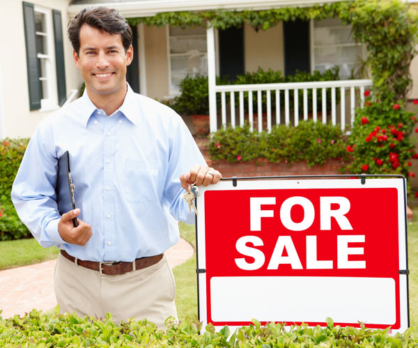 realtor and for sale sign