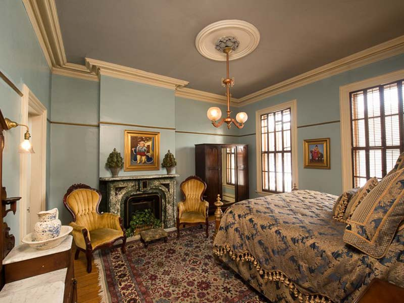 Room with crown molding and other Victorian touches at The Mansion Inn of Saratoga