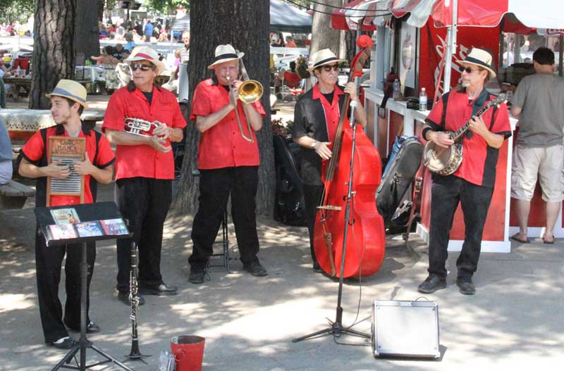 Band dressed in red and black playing at Saratoga Race Course