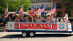 Patriotic Parade float traveling down Broadway in Saratoga Springs NY