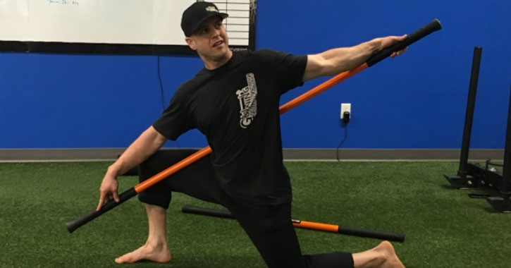 man in gym with mobility stick