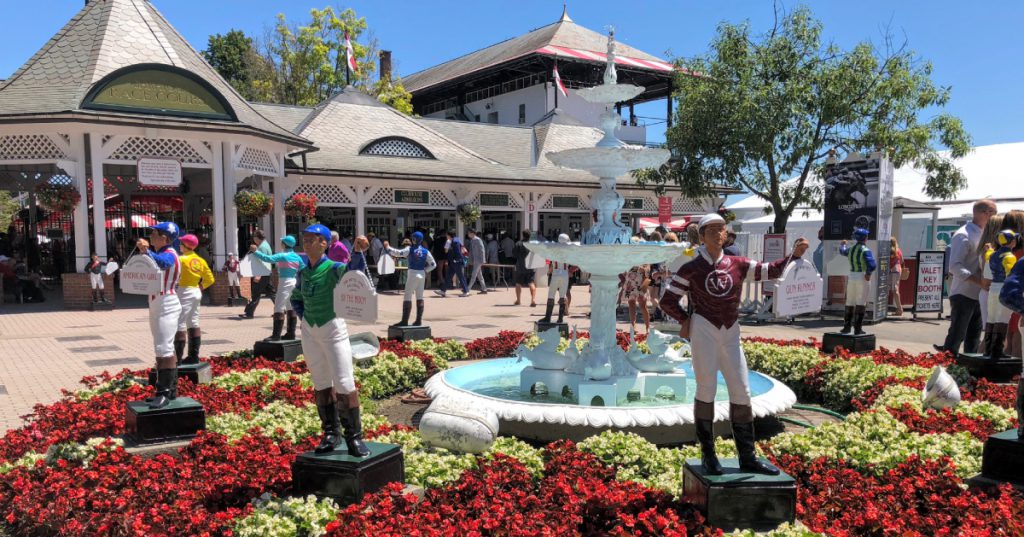 statues and fountain at entrance of racetrack