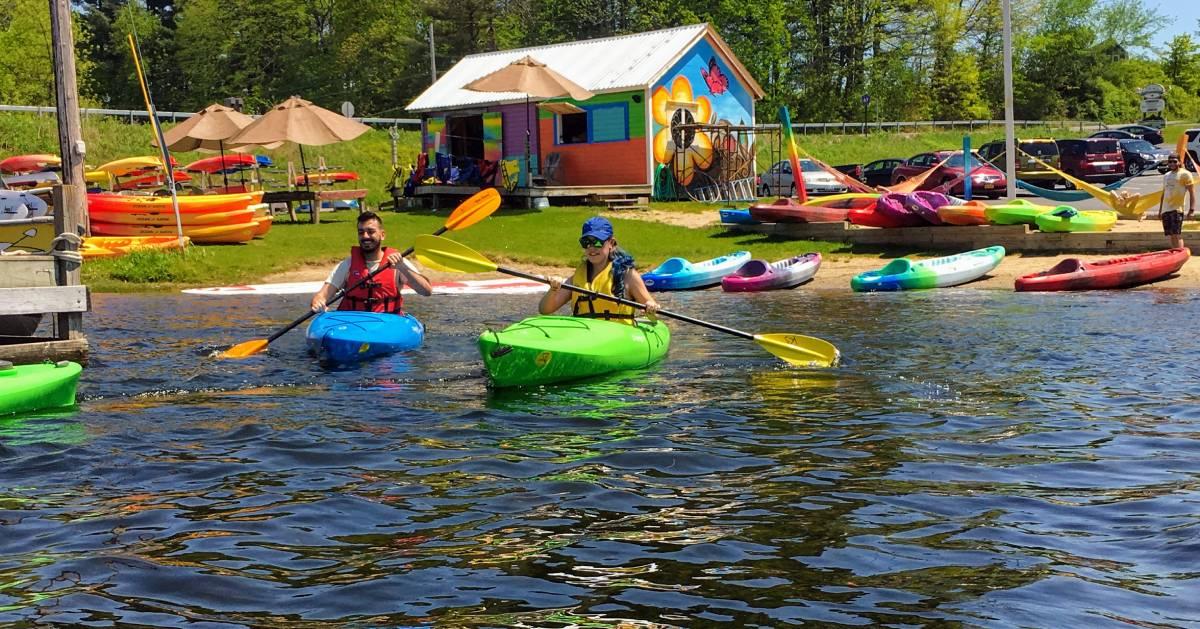 people in colorful kayaks