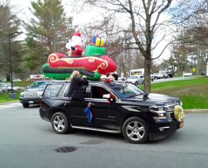 a black car with a holiday float on top