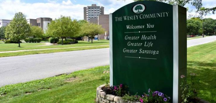 a green sign for the wesley community