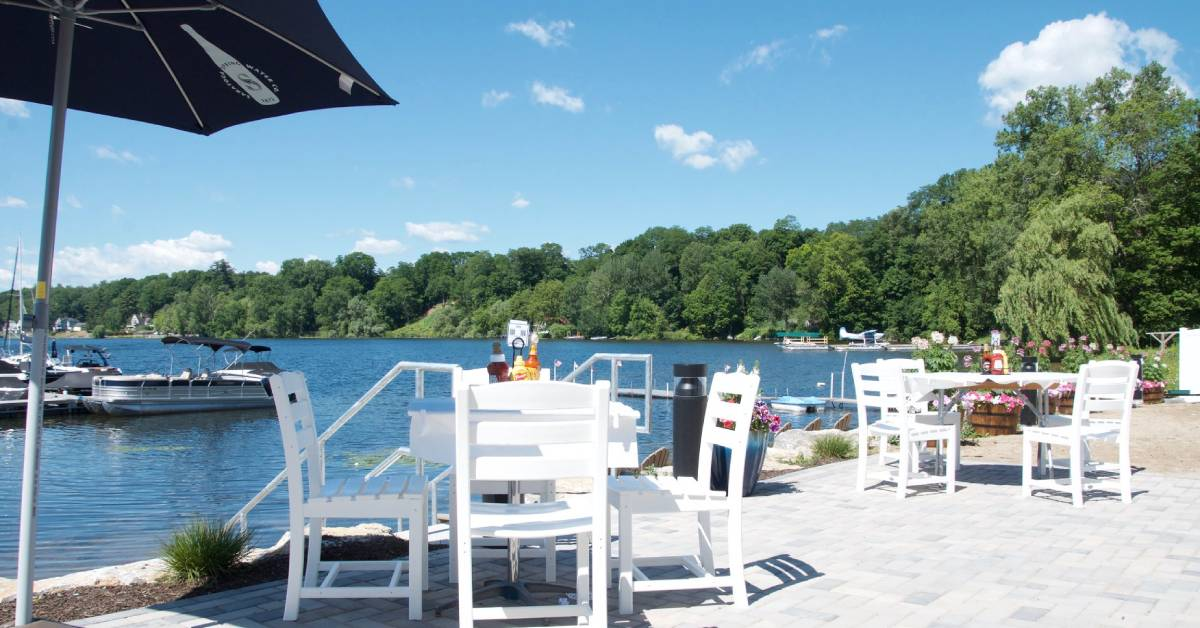 outdoor chairs on patio by water