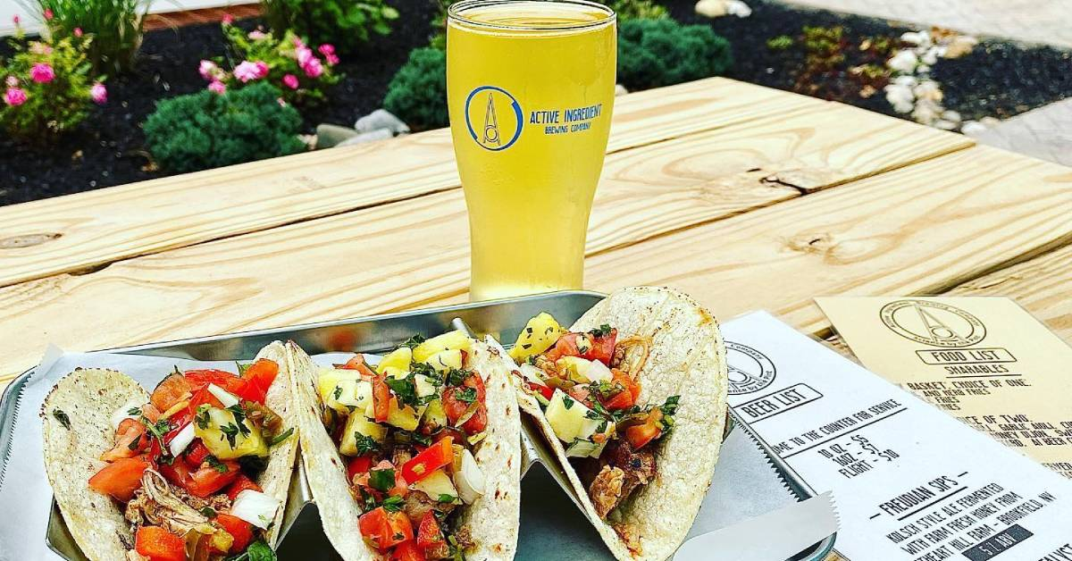 tacos and glass of craft beer on outdoor table