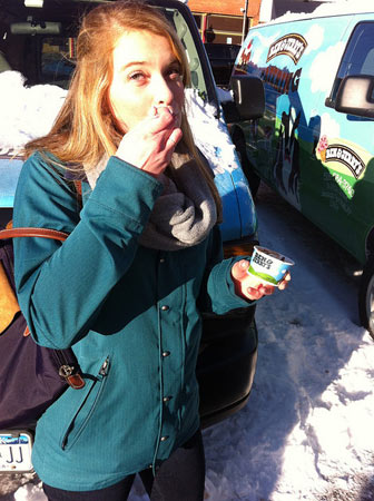 a woman eating chowder from ben and jerry's