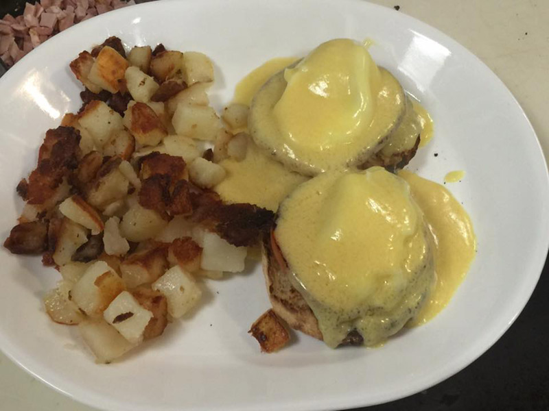 Eggs Benedict with homefries at Compton's in Saratoga Springs