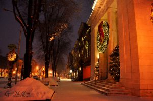 The Adirondack Trust Company on Broadway with a festive view of Broadway.