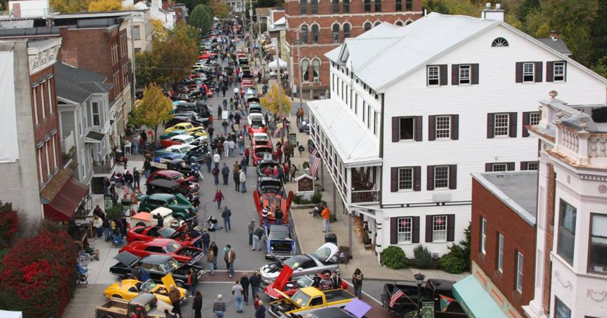aerial shot of a car show in a village