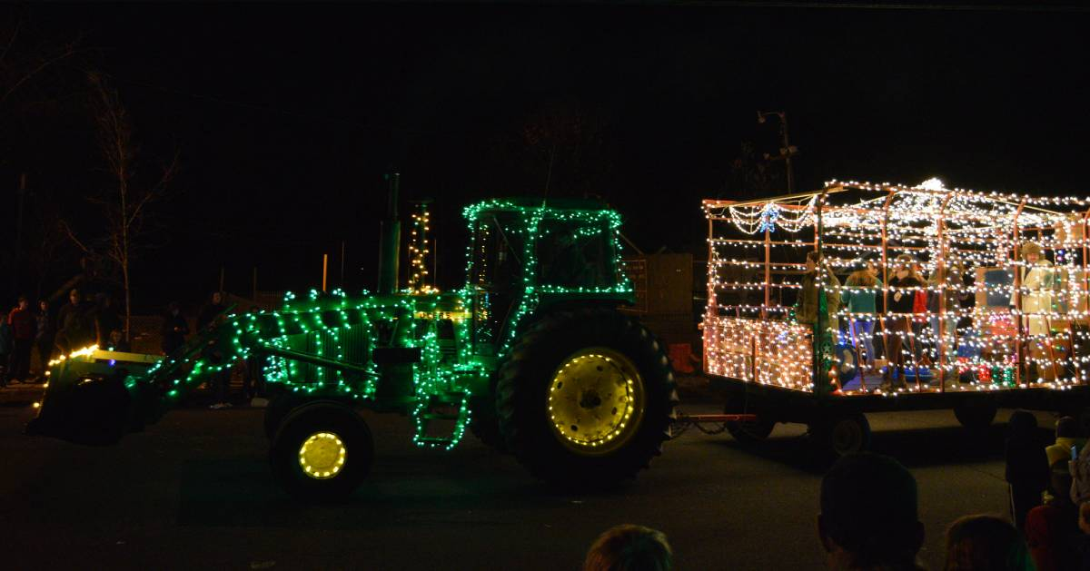 tractor in parade with holiday lights