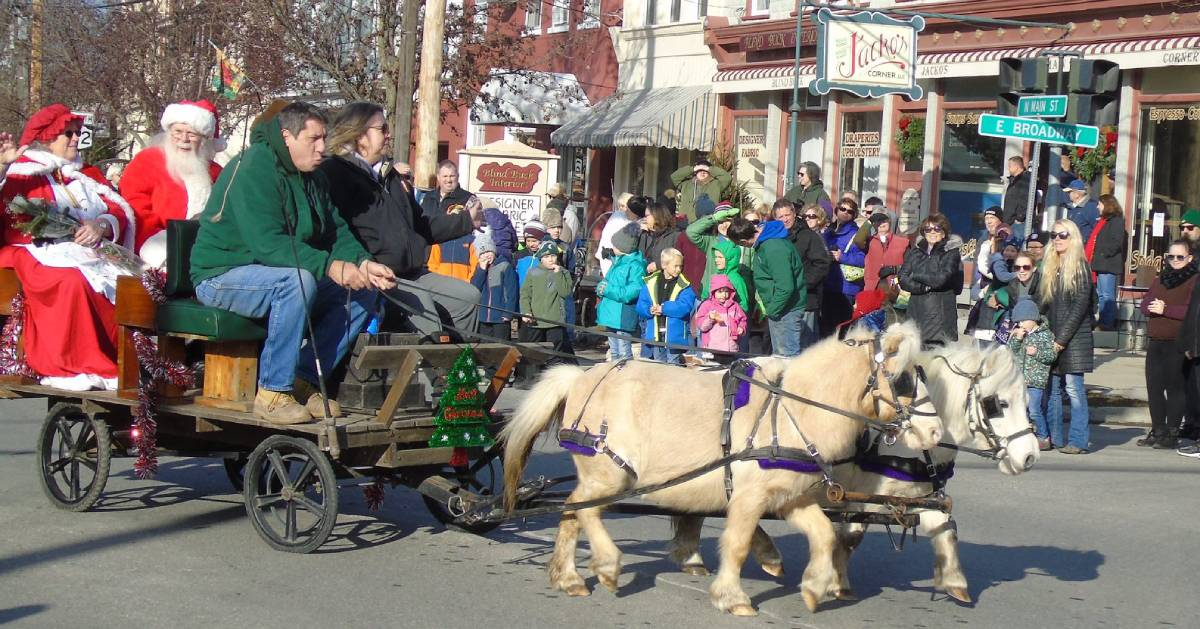 holiday parade display pulled by horses