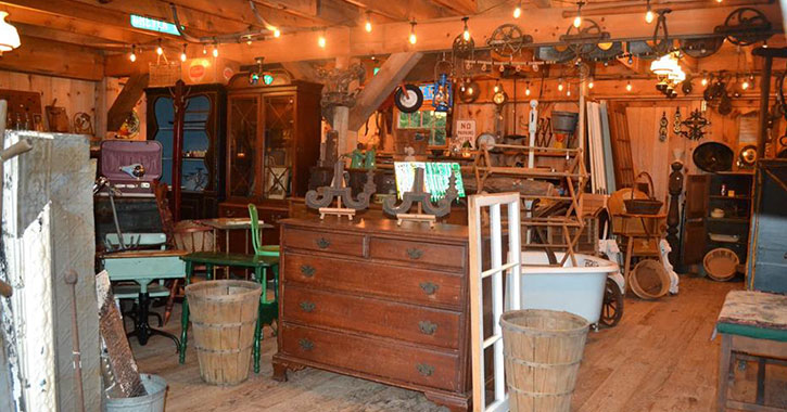 inside a barn filled with antiques
