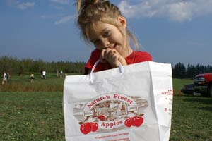 Child Holding Bag At Apple Orchard