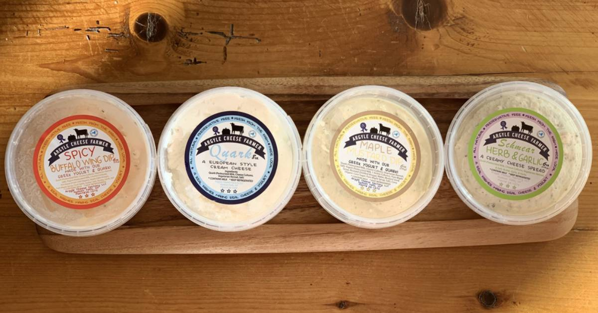 four containers of cheese