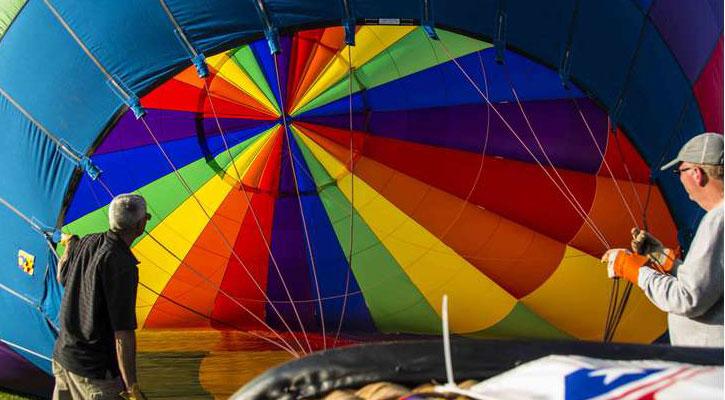 men setting up a hot air balloon
