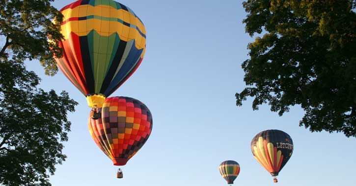 four hot air balloons in the air
