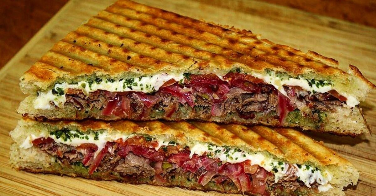 two halves of a brisket panini