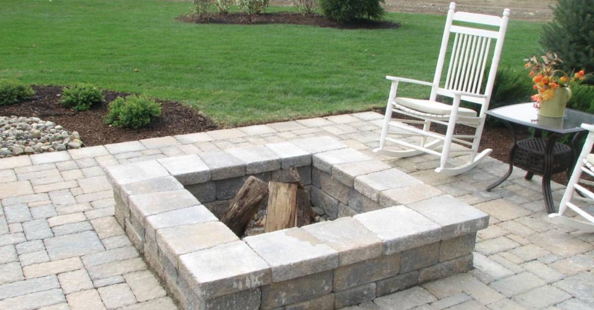 a paver patio with a fire pit