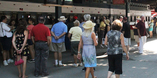 people placing bets at Saratoga Race Course