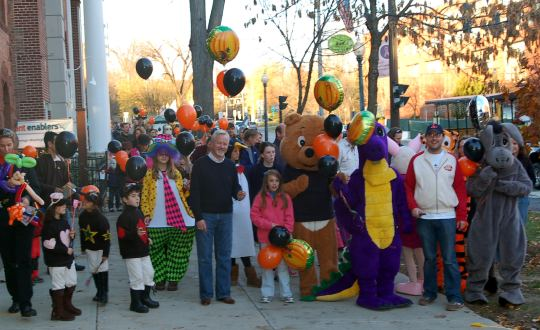 group of people at a fall festival