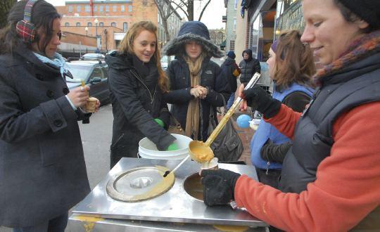 people serving chowder samples