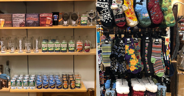 split image with shotglasses and things on shelves on the left and colorful socks on the right