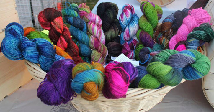 a basket of colorful yarns