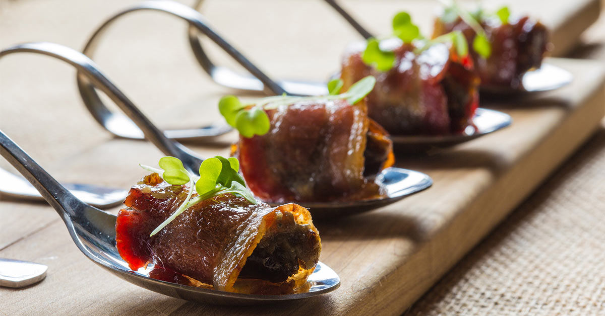 bacon wrapped appetizers on spoons