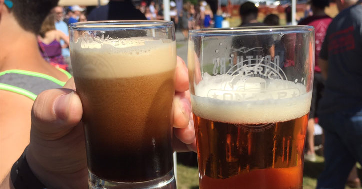 two glasses of beer with Brewfest crowd in the background