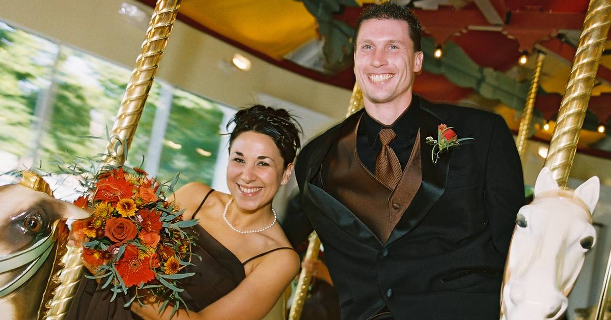 bridesmaid and groomsman on carousel
