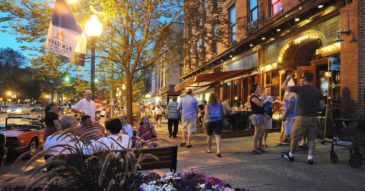 people strolling along downtown saratoga in the evening