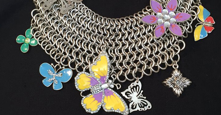 a thick chain neclakce with butterfly pendants