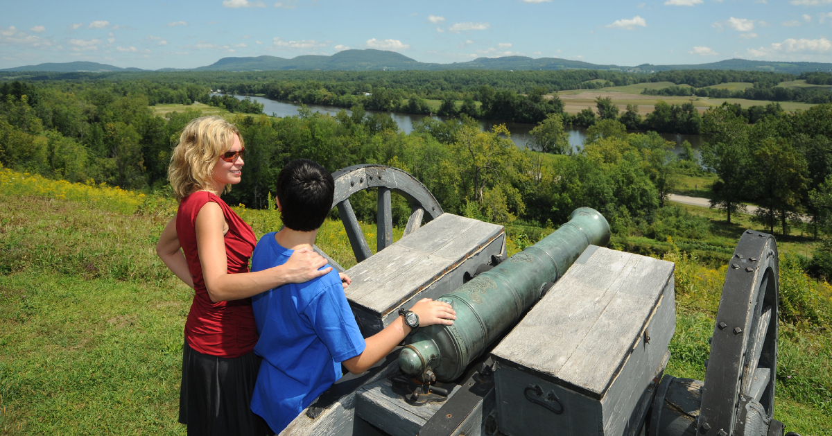 woman and teen near a cannon