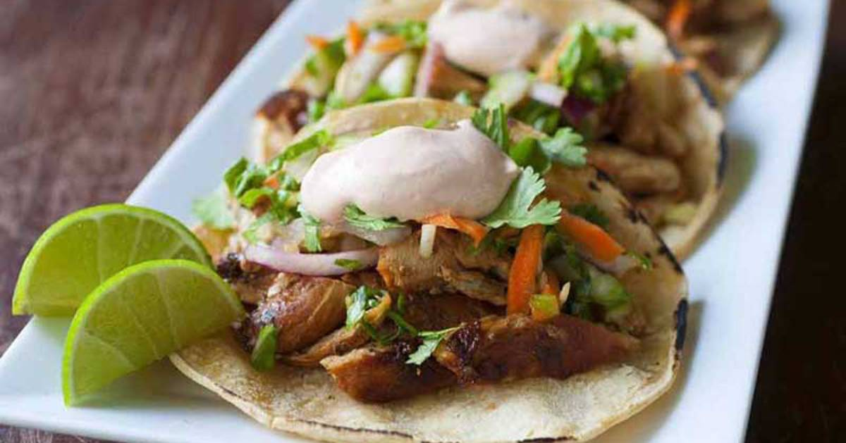tacos with lime wedges
