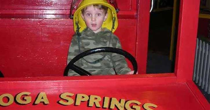 child rides toy fire engine