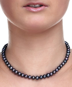dark gray beaded choker necklace on woman's neck