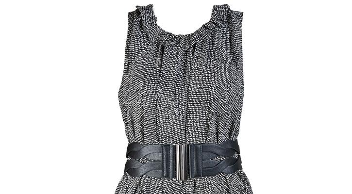 a chuncky black belt wrapped around a black and gray dress