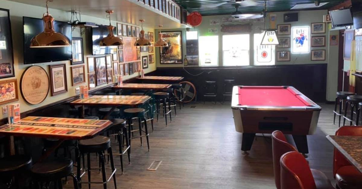 tables and pool table in a bar area