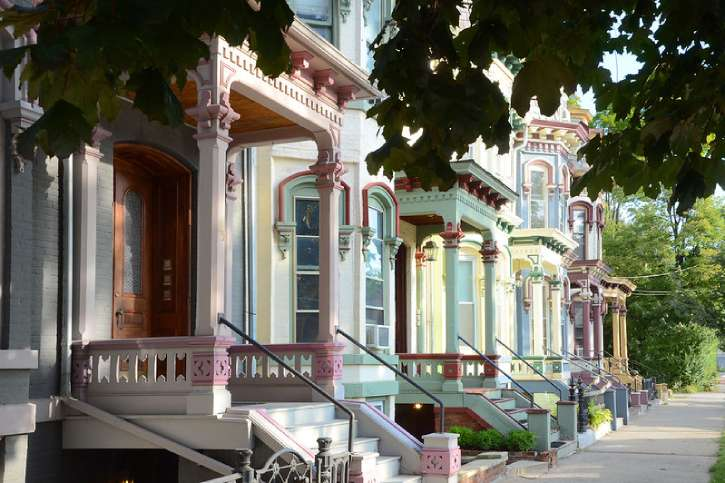 brightly painted victorian houses on clinton st.