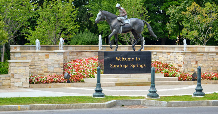 a horse statue with sign that says welcome to Saratoga