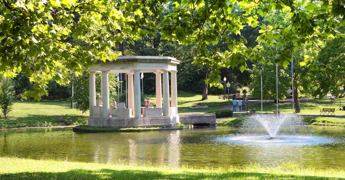 a gazebo in the middle of a pond in congress park
