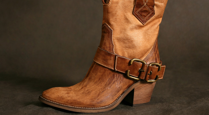 a brown leather cowboy boot