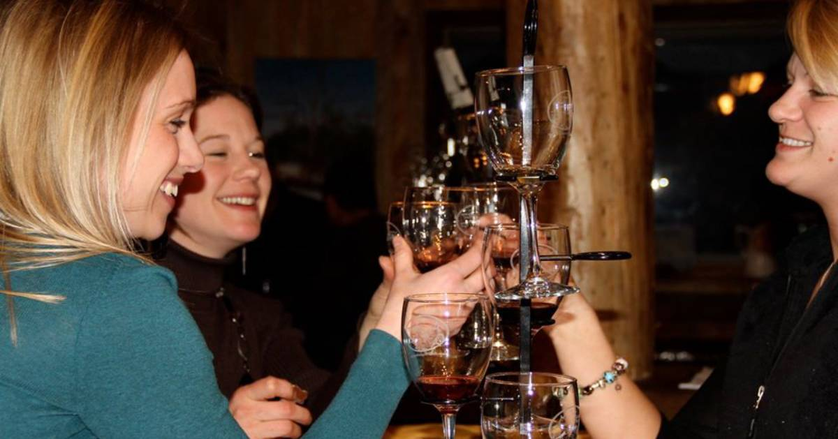 women tasting wines from glasses