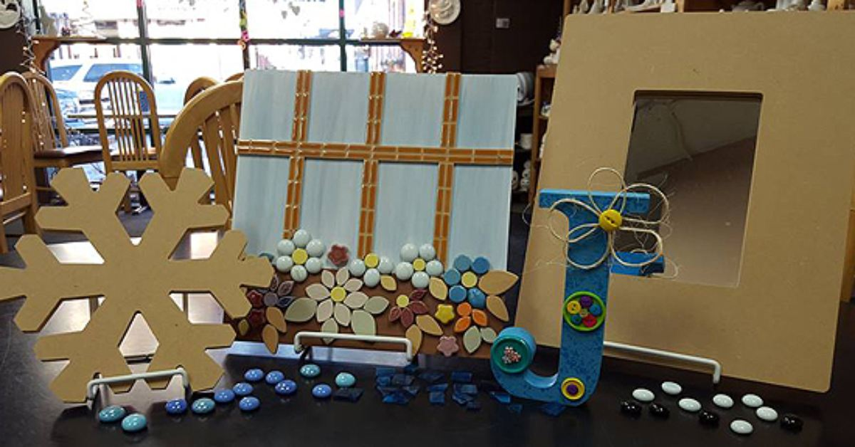 ceramic and mosaic projects on a table