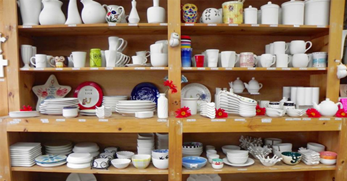 shelves of ceramic items that can be painted