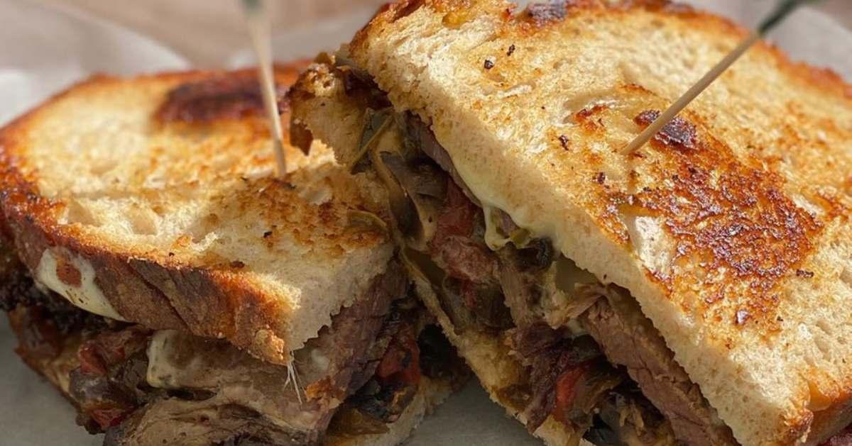 roast beef sandwich cut in half