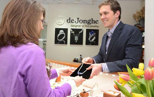 people handling silver jewelry