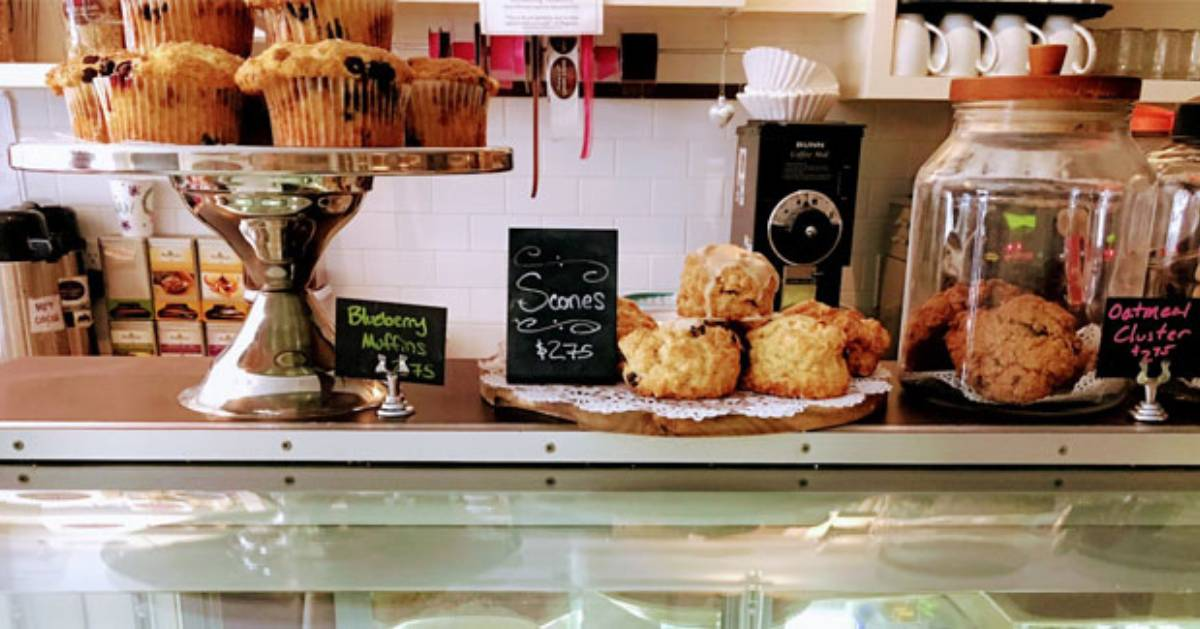 baked goods on a front counter in a bakery